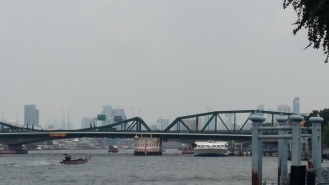 ... passing Phra Pokklao Bridge...