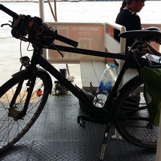 ... we cross the river and back through Bangkok Southward...