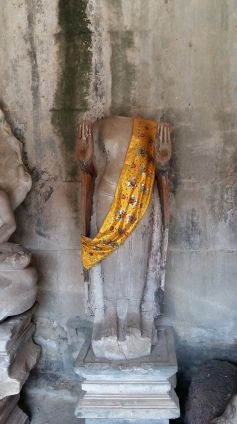 In Angkor Wat statues are being dressed up for New Year Ceremony